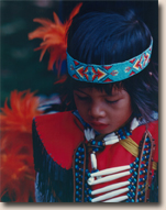 boy in Native American regalia